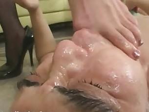 Mistress dominates slave by feet as he masturbates