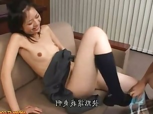 2 Asian Schoolgirls In Skirts Licking And Fingering Pussies On The Couch In The