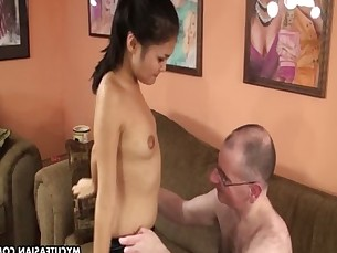 Asian sucking off a very hairy sasquatch in bed