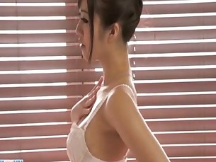 Kotomi plays with glass toy down her hairy pussy