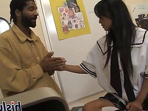 Asian schoolgirl pleasures a big black cock